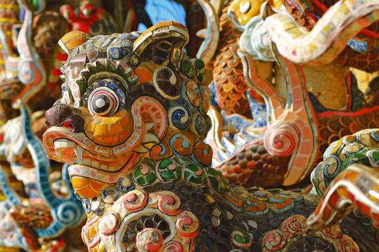 Mosaic Sculptures Details of a Buddhist Temple in a village near Da Lat, Vietnam