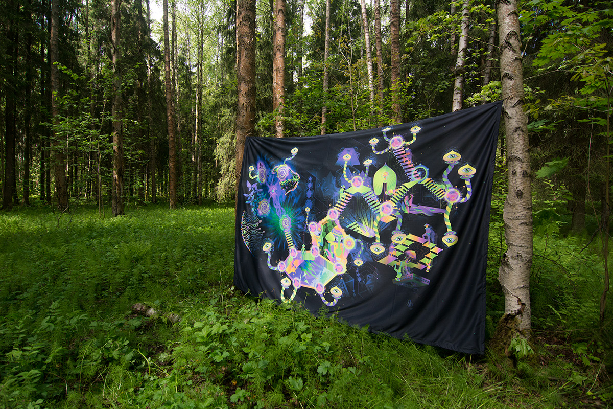 Psilocybin World fluorescent backdrop in the forest