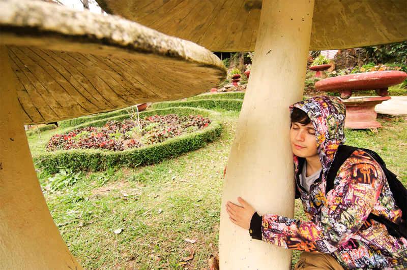 Andrei Verner hugging a huge mushroom in Valley of Love, Da Lat, Vietnam